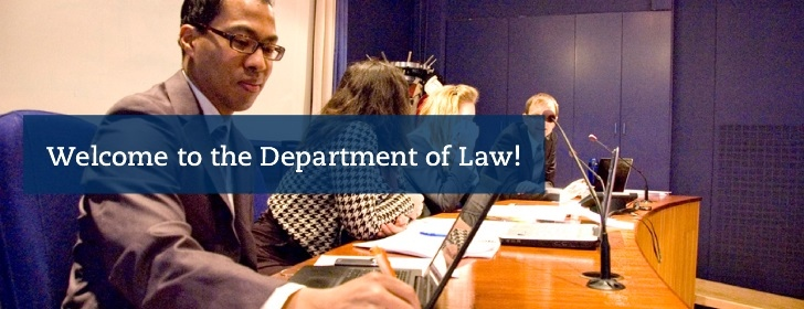 """Welcome to the Department of Law!"" Picture showing a mock trial."